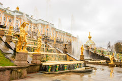 Grand Palace and the Grand cascade fountains in Petergof. The fountains and palace of Petergof are one of Russia`s most famous tourist attractions Royalty Free Stock Photos