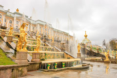 Grand Palace and the Grand cascade fountains in Petergof. The fountains and palace of Petergof are one of Russia`s most famous tourist attractions Royalty Free Stock Image