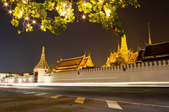 The Grand palace at night in Bangkok Stock Photo