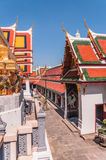 Grand Palace orange roofs against blue sky Royalty Free Stock Images