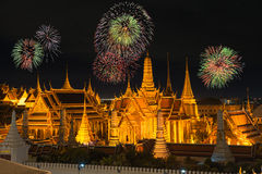 Grand palace and Wat phra keaw in night with new year fireworks Royalty Free Stock Images