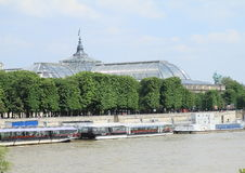 Grand Palais behind Seine Stock Image