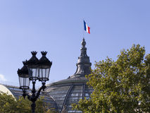 Grand Palais dome. The top of the dome of the Grand Palais in Paris with the french flag flying Royalty Free Stock Image