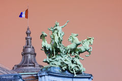 Grand Palais in Paris. Statue on the Grand Palais in Paris, France, at the Champs Elysees, created for the Universal Exposition of 1900. The statue depicts royalty free stock photos