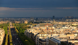 Grand Palais skyline. Dramatic skyline view towards the Champs-Elysees and the Grand Palais with the Louvre and Notre-Dame in the background in Paris, France Stock Photos