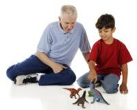 Grand-papa, dinosaures et moi Photographie stock libre de droits