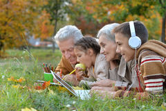 Grand parents spending time with grandchildren. Outdoors in autumn stock photography