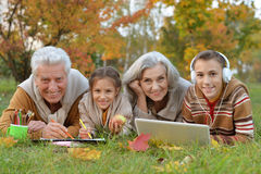 Grand parents spending time with grandchildren. Outdoors in autumn royalty free stock photos
