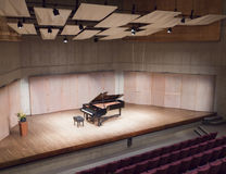 Grand piano. And bench on the concert scene Royalty Free Stock Image