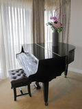 Grand piano. Closed with vase of flowers on top in a Presidential suite luxury hotel room royalty free stock photos