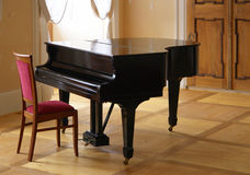 Grand piano. Black piano on old  concert hall Royalty Free Stock Images