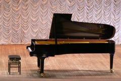 Grand piano. Brilliant grand piano on a beautiful stage stock photography