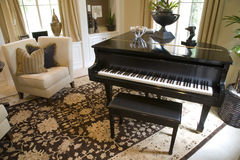 Grand piano. In a modern luxury home royalty free stock image