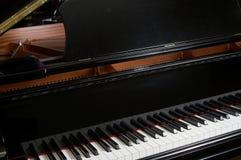 Grand Piano. Closeup of ebony grand piano music keys royalty free stock photography
