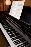 Grand piano. Keyboard sideview with song book Royalty Free Stock Photo