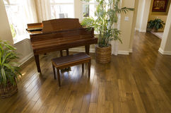 Grand piano. And hardwood floor in a luxury home stock image