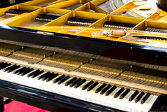 Grand Piano Being Tuned. Open Grand piano with tuning tools in preparation for tuning royalty free stock photography