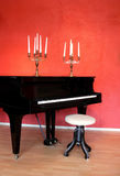 Grand Piano and Candelabras. A grand piano and candelabras in an art galleri Stock Images