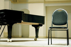 Grand piano and chair Stock Image