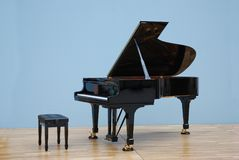 Grand piano in concert hall. Luxurious Grand Piano in a blue painted room in concert hall stock photos
