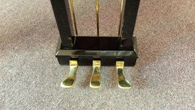 Grand piano gold pedals Royalty Free Stock Photo