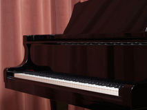 Grand Piano keyboard on the concert stage. Keyboard on the grand piano on stage with curtains in background Royalty Free Stock Images