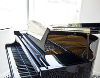 Grand piano keys. A close up image of a nice grand piano sitting in the living room ready for the next musical performance royalty free stock photos