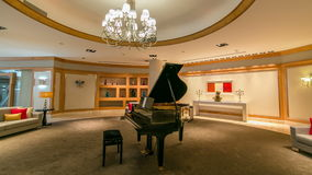 Grand piano in a luxury interior timelapse. Hyperlapse with sofa and chandelier stock footage