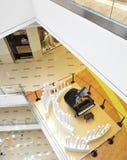 Grand piano in modern lobby stock photos