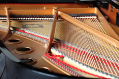 Grand piano opened. Strings and mechanics inside a grand piano royalty free stock image