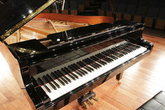Grand piano. On the stage royalty free stock photos