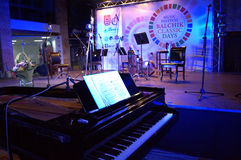 Grand piano at concert stage Stock Image