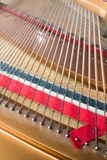 Grand piano strings. Piano inside Stock Photography