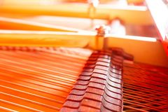 Grand piano strings, steel wire core wound with copper wire. Musical instrument abstract royalty free stock image