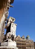 Grand Place in Brussels. Statue of a lion at the entrance of the town hall at the Grand Place in Brussels Stock Images