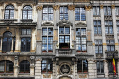 Grand Place - Brussels. Various store fronts that were built in the 17th century are currently in a square that houses a museum, hotel and many pubs stock photo