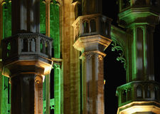 Grand Place in Brussels, Belgium. Green and yellow night illumination of medieval tower on Grand Place in Brussels, Belgium Stock Photos