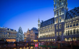Grand Place Brussels at Christmas. Grand Place Brussels light show and a huge Christmas Trees and people enjoying the celebration Stock Photography