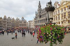 Grand Place in Brussels. Many tourists walk and look at beautiful buildings on the main square in Brussels. Flowers bloom on the Grand Place in Brussels stock image