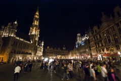 Grand Place Bruxelles. At night with people and lights - shot with an ultra wide lens - Bruxelles, Belgium 2011 stock photo