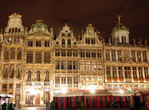 The Grand Place in the central square of Brussels. It is surrounded by opulent guildhalls and two larger edifices, the city's Town Hall, and the Breadhouse stock photo