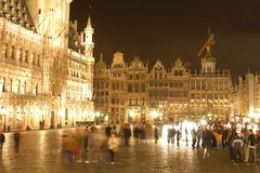 Grand Place by night. With moving people - Brussels, Belgium Stock Images