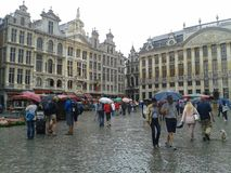 Grand place raining, brussels stock images