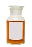 Grand pot en verre avec un couvercle, rempli du miel jaune foncé Image libre de droits