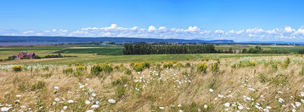 Grand Pré panorama, Nova Scotia. Large panorama of the Grand Pré great meadow with the Evangeline Memorial Church, Nova Scotia, Canada--a UNESCO World Heritage Royalty Free Stock Photo