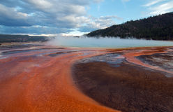 The Grand Prismatic Spring at sunset in the Midway Geyser Basin along the Firehole River in Yellowstone National Park in Wyoming Stock Photo