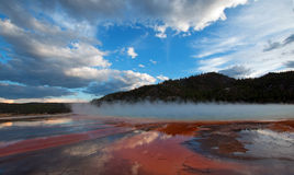 The Grand Prismatic Spring at sunset in the Midway Geyser Basin along the Firehole River in Yellowstone NP in Wyoming US Royalty Free Stock Images