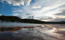 The Grand Prismatic Spring at sunset in the Midway Geyser Basin in Yellowstone National Park in Wyoming US Stock Image