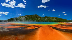 Grand Prismatic Spring in Yellowstone National Park. Рanorama of the Grand Prismatic Spring in Yellowstone National Park WY USA. In the background are visible stock images