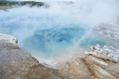 Aquamarine Colored Hot Pool With Steam At Yellowstone National Park. Grand Prismatic Spring at Yellowstone National Park Royalty Free Stock Image